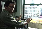 Mudrick at the window where he shot WTC Uncut