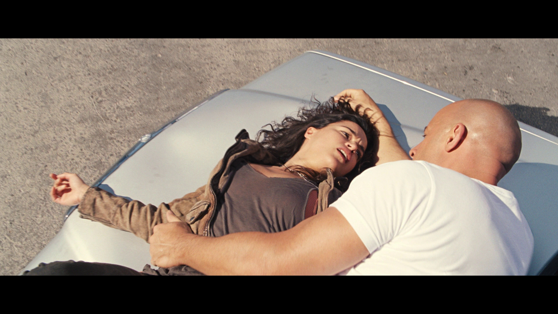 Dom saves Letty amidst a fight causing her to re-join his team, although she doesn't remember him.